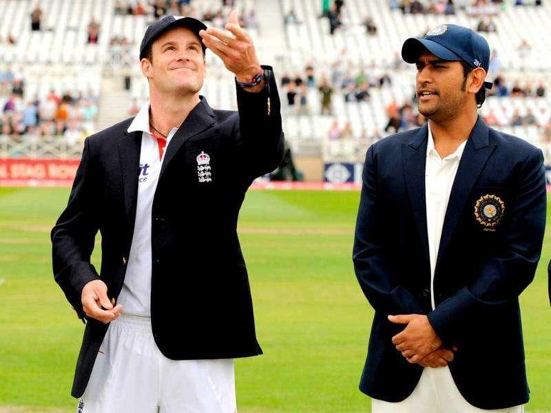 England's Andrew Strauss tosses the coin standing next to India's captain Mahendra Singh Dhoni before the second cricket Test match at Trent Bridge in Nottingham.