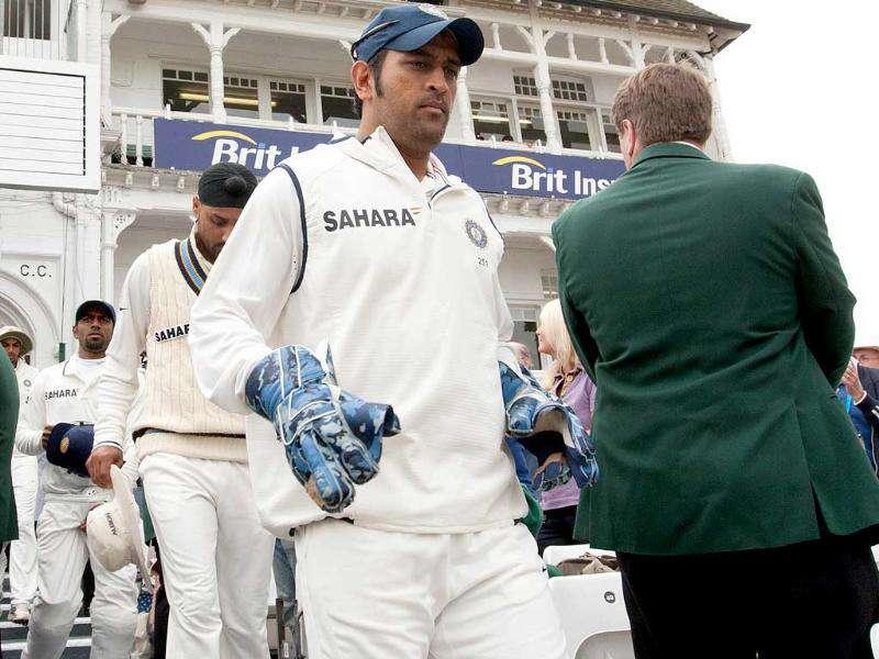 Indian captain MS Dhoni leads his team into the field on the first day of their cricket Test match against England at Trent Bridge Cricket Ground, Nottingham.