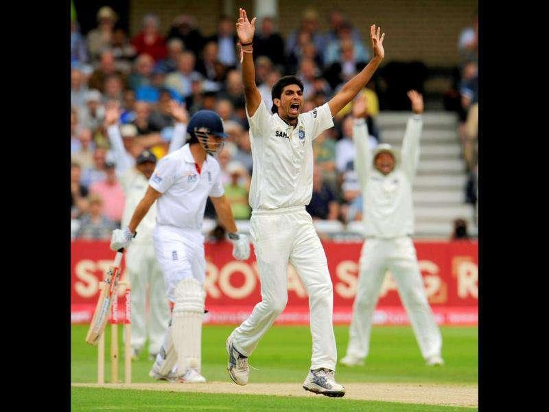 India's Ishant Sharma dismisses England's Alastair Cook for two runs during their second cricket Test match at Trent Bridge in Nottingham.