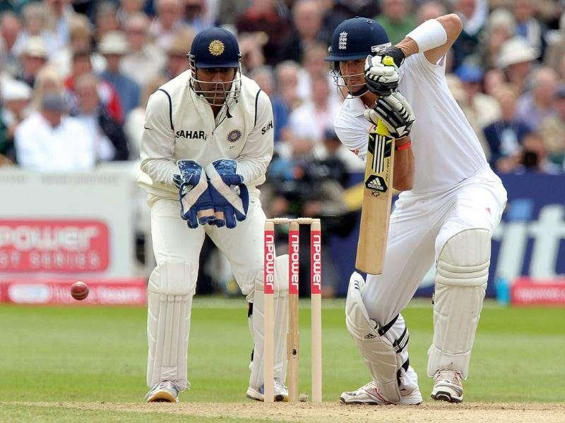 Kevin Pietersen plays a shot past MS Dhoni during the first day of the second cricket Test match between England and India at Trent Bridge in Nottingham.
