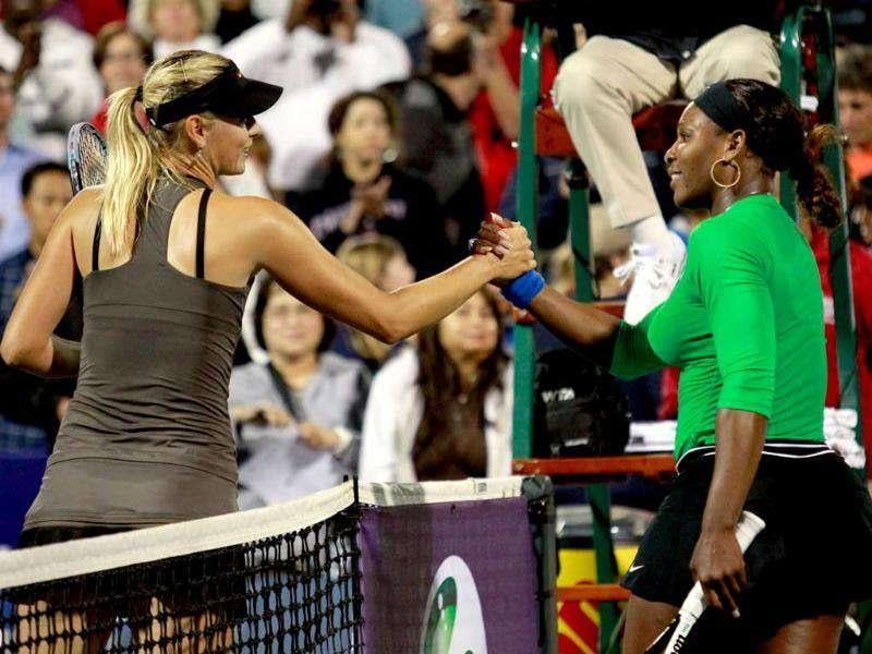 Serena Williams of the US (R) shakes hands with Russia's Maria Sharapova after winning their Stanford Classic tennis match in Stanford, California.