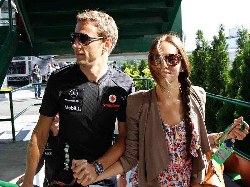 McLaren Formula One driver Jenson Button of Britain arrives with his girlfriend Japanese-Argentine model Jessica Michibata at the Hungaroring circuit near Budapest.
