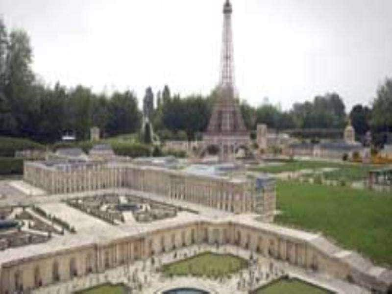 A miniature replica shows Versailles Castle and its gardens, in front of the Paris Eiffel Tower at the 'France Miniature' leisure Park Elancourt.