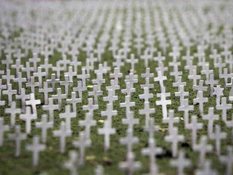 Crosses and a star of David from a miniature replica of Colleville-sur-mer American World War II cemetery and memorial, located in western France, are pictured at the 'France Miniature' leisure Park.
