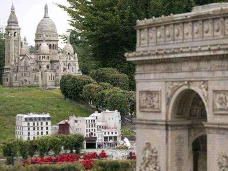 Miniature replicas of Paris Arch of Triumph, Moulin Rouge cabaret and Sacre Coeur Basilic are pictured at the 'France Miniature' leisure Park.