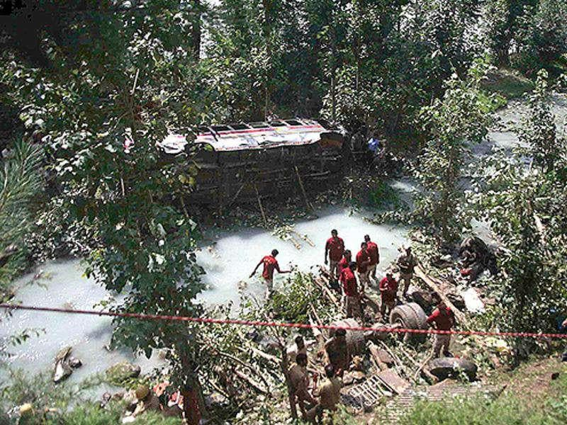 Rescue workers collect wreckage of a bus that plunged into Lidder stream ,80 km south of Srinagar.