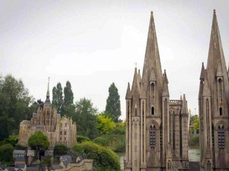 A miniature replica of the Cathedral of Coutances is pictured next to the Mont Saint-Michel (L), at the France Miniature leisure Park in Elancourt, a western Paris suburb.