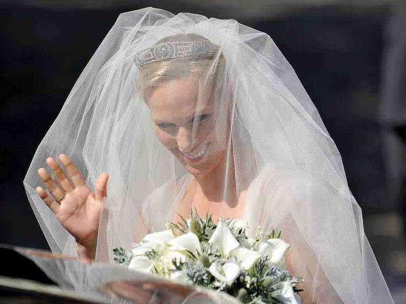 Britain's Zara Phillips, the eldest granddaughter of Queen Elizabeth, arrives for her wedding to England rugby captain Mike Tindall, at Canongate Kirk in Edinburgh, Scotland.