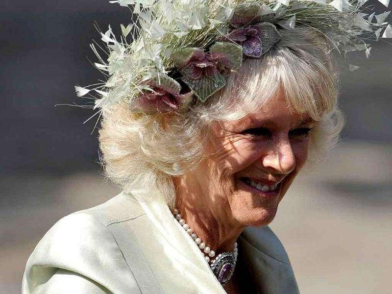 Camilla, Duchess of Cornwall, arrives for the marriage of Britain's Zara Phillips, the eldest granddaughter of Queen Elizabeth, and England rugby captain Mike Tindall, at Canongate Kirk in Edinburgh, Scotland.
