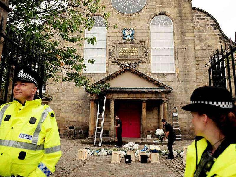 Police oversee the final preparations at the Canongate kirk in Edinburgh ahead of the wedding of equestrian star Zara Phillips, daughter of Princess Anne, the Princess Royal, set to take center stage as she marries England rugby stalwart Mike Tindall.