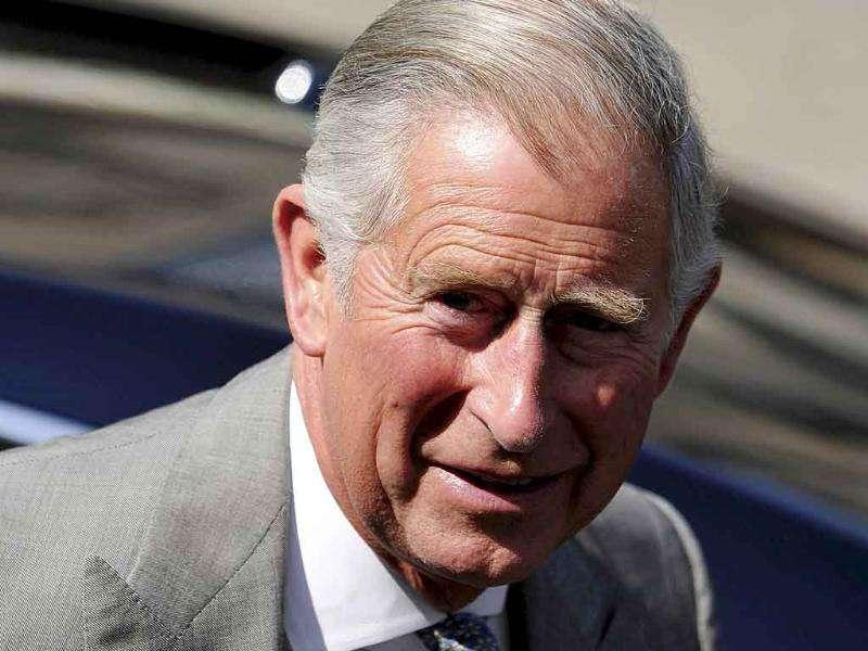 Prince Charles arrives before the marriage of Britain's Zara Phillips, the eldest granddaughter of Queen Elizabeth, and England rugby captain Mike Tindall, at Canongate Kirk in Edinburgh, Scotland.