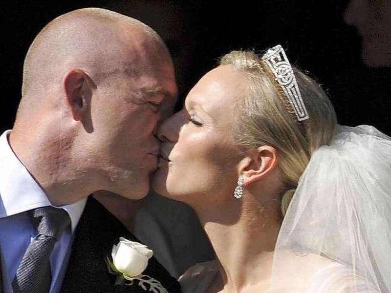 Britain's Zara Phillips, the eldest granddaughter of Queen Elizabeth, kisses her husband England rugby captain Mike Tindall, after their marriage at Canongate Kirk in Edinburgh, Scotland.