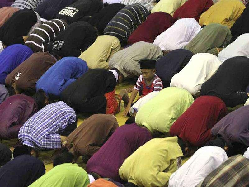 Malaysian Muslims offer congregational prayers during the first night of Ramadan in Kuala Lumpur.