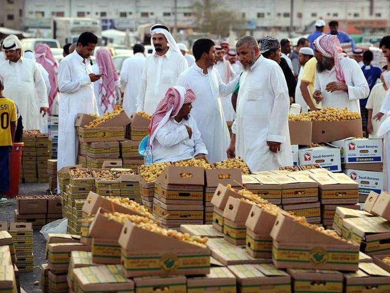 Saudis buy and sell dates on the eve of the Muslim holy fasting month of Ramadan at a market in Riyadh.