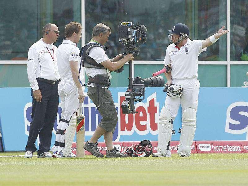 England's Ian Bell, right, reacts as he is controversially given out after walking from the pitch for tea mistakenly believing a ball had gone for four and play had therefore been stopped on the third day of his team's cricket test match at Trent Bridge cricket ground, Nottingham, England.
