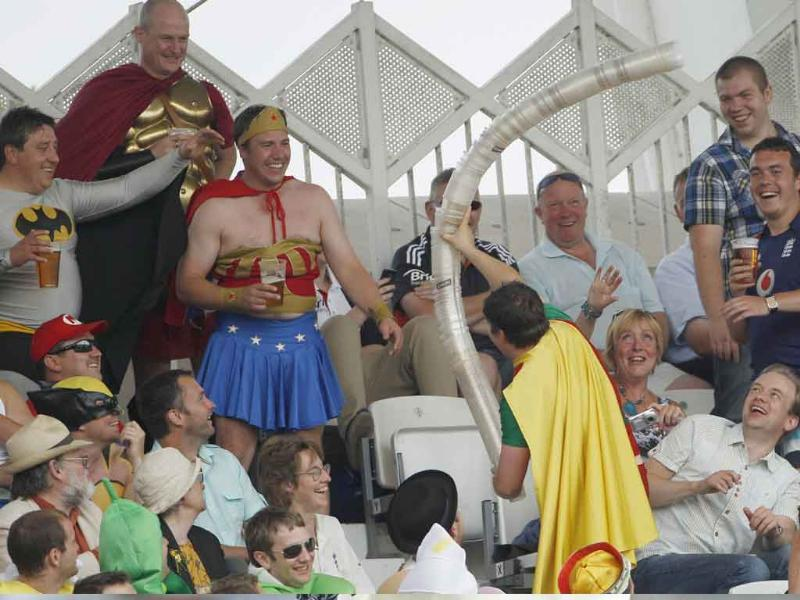 A fan carries a beer glass snake as England play India during the third day of the second cricket Test match at Trent Bridge in Nottingham, central England.