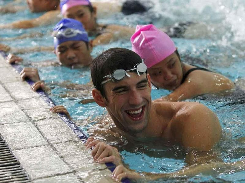 US Olympic medallist Michael Phelps teaches Chinese Special Olympics athletes how to swim during an event in the Special Olympics in Shanghai. Phelps had been appointed a Special Olympics Global Ambassador.