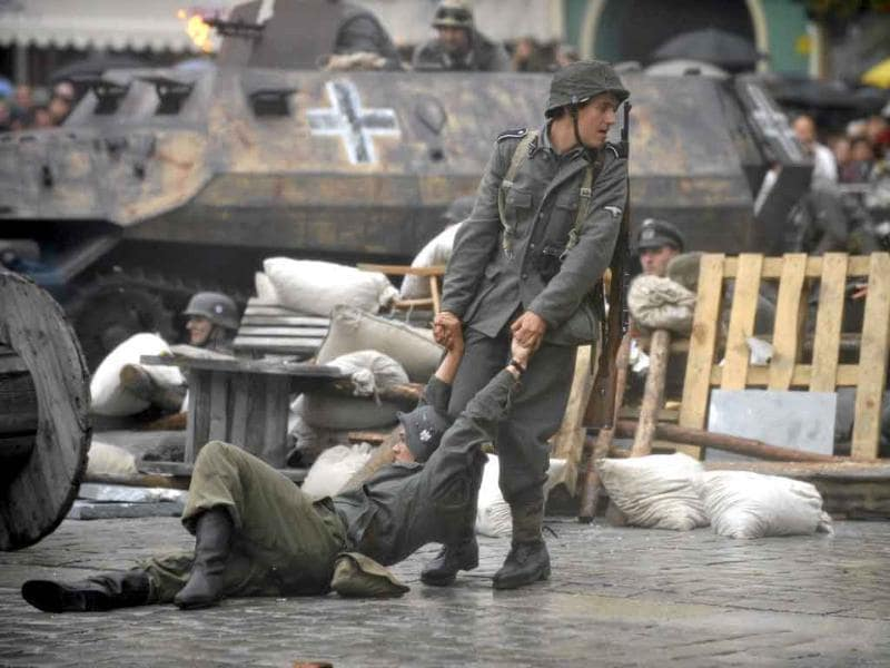 Actors re-enact scenes from the Warsaw Uprising during World War Two in the city of Wroclaw. Poland today commemorates the 67th anniversary of the uprising, a nationwide rebellion against German occupation on August 1.