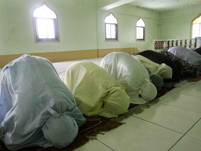 Filipino Muslim women pray inside a mosque during the first day of the holy fasting month of Ramadan in suburban Paranaque, south of Manila, Philippines. During Ramadan, the holiest month in Islamic calendar, Muslims refrain from eating, drinking, smoking and sex from dawn to dusk.
