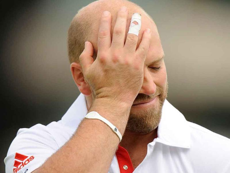 England's Matt Prior rubs his head as he leaves the field after being dismissed for 73 during the second cricket Test match against India at Trent Bridge in Nottingham.