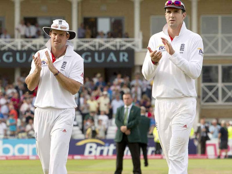 England's captain Andrew Strauss applauds as he walks from the pitch with Kevin Pietersen after their 319 run win over India on the fourth day of their cricket Test match at Trent Bridge cricket ground, Nottingham, England.