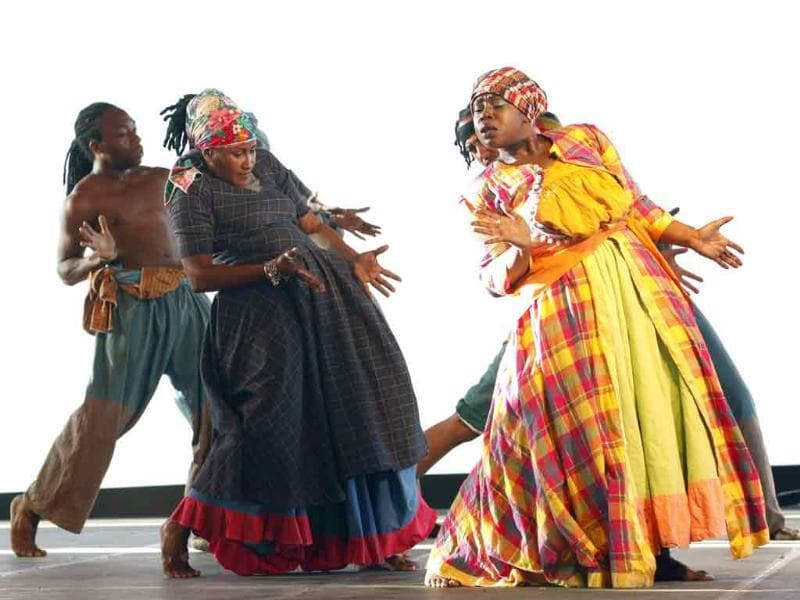 Members of the Something Positive dance company from New York perform at Lidj Yasu Omowale village during celebrations for Emancipation Day in Port of Spain. Emancipation Day commemorates the liberation of formerly enslaved Africans and their struggles and resistance to the institution of slavery.