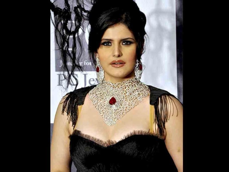 Zarine Khan, who walked the ramp for Johara Jewels, presented a very boring creation.
