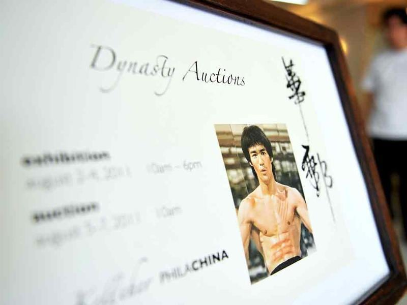 A man walks past an auction poster for the upcoming sales of the late kung fu legend Bruce Lee in Hong Kong.