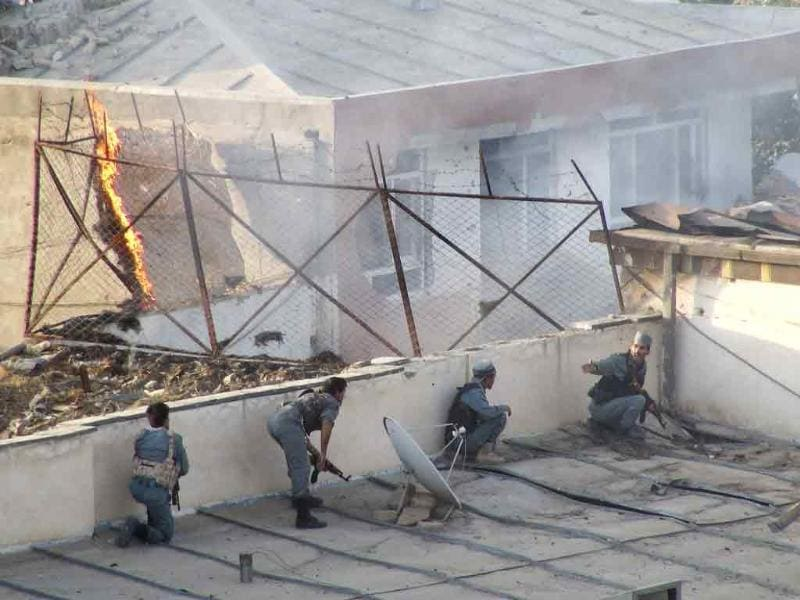 Police fight suicide attackers who took over a guesthouse in Kunduz province.