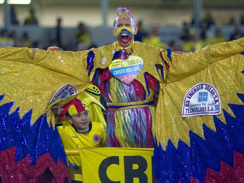 Colombia's fan known as 'El Cole' cheers prior to a U-20 World Cup group A soccer match against Mali in Bogota, Colombia.