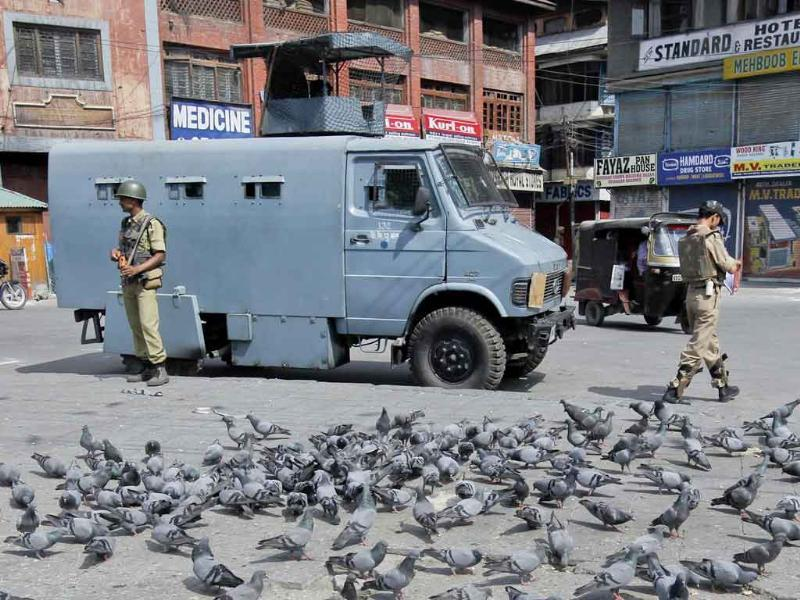Policemen patrol the streets during a strike in Srinagar.