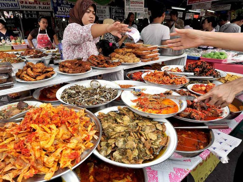 Vendors sell food for Muslims to break their fast on the third day of Ramadan in Jakarta.