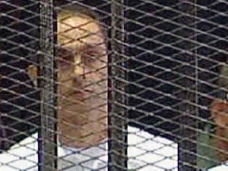In this image taken from Egyptian State television on Wednesday, Gamal Mubarak is seen in a holding cell in the court room in the police academy on the outskirt of the capital Cairo, waiting for the start of their trial along with his father ousted Egyptian president Mubarak.