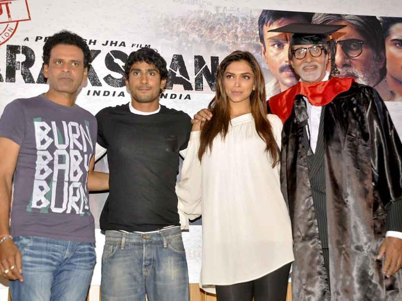 Manoj Bajpayee, Prateik Babbar, Amitabh Bachchan and Deepika Padukone pose during a press conference to promote the forthcoming movie Aarakshan. (AFP)