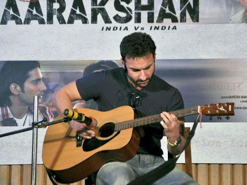 Saif Ali Khan plays guitar at the promotional event for Aarakshan.