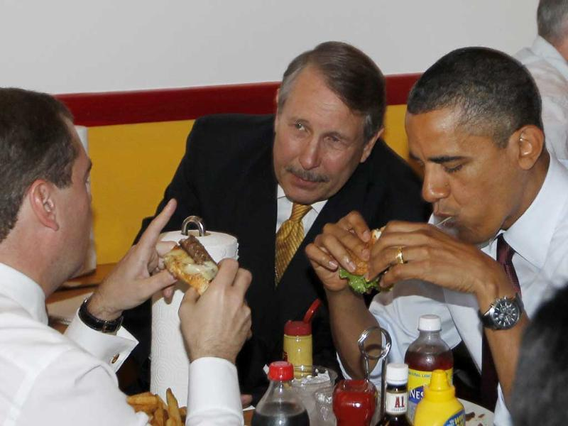 A file image of US President Barack Obama and Russia's President Dmitry Medvedev eating hamburgers as they make an unscheduled visit to Ray's Hell Burger in Arlington, Va.