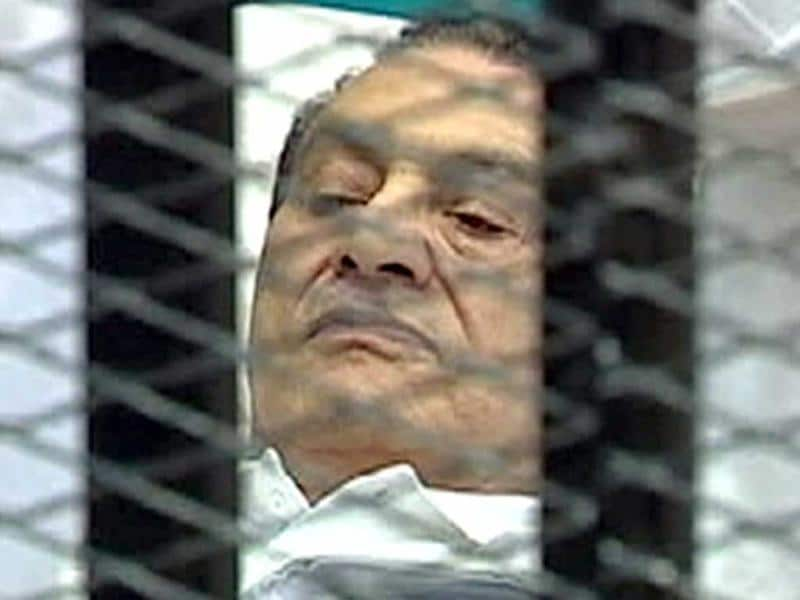 Former Egyptian president Hosni Mubarak is seen in the courtroom for his trial at the police academy in Cairo.  (Reuters/Egypt TV)