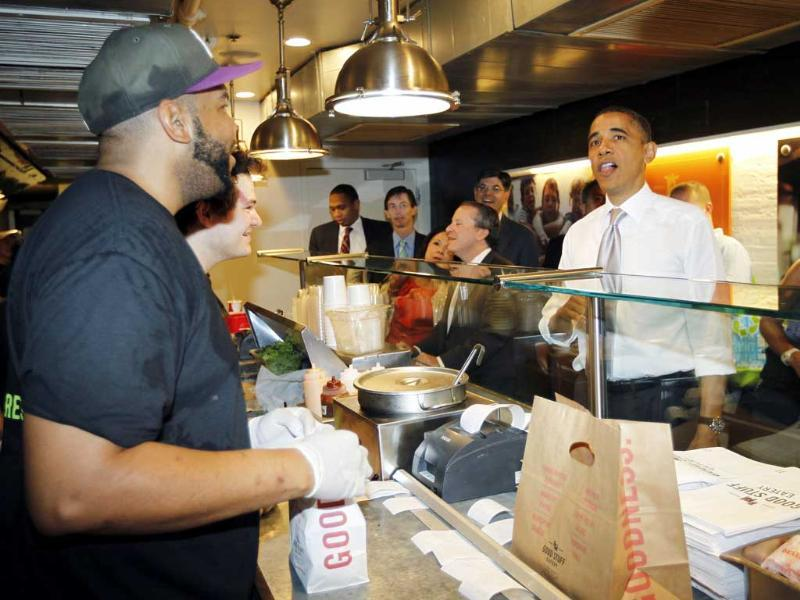 US President Barack Obama orders a burger and fries at the Good Stuff Eatery on Capitol Hill in Washington.