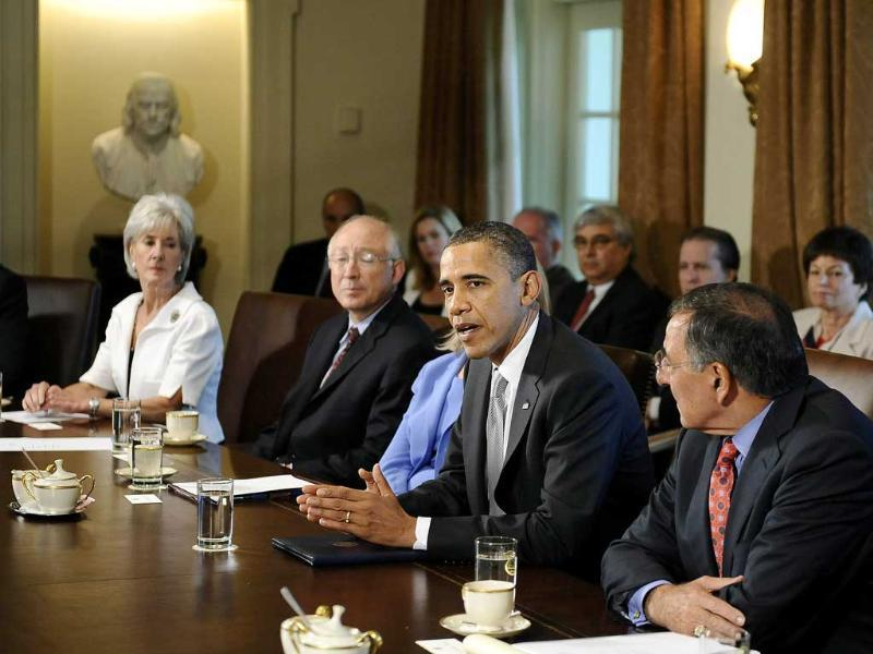 US President Barack Obama smiles during a cabinet meeting at the White House in Washington.
