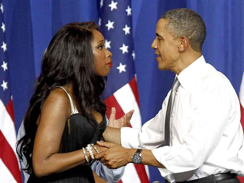 US President Barack Obama is greeted by singer Jennifer Hudson at a Democratic National Committee event at the Aragon Entertainment Center in Chicago.