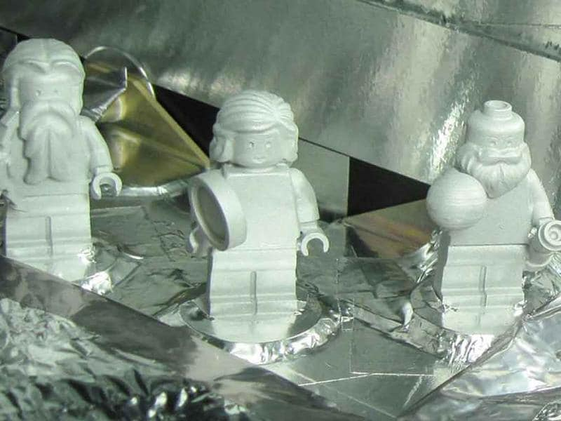 Lego figurines representing the Roman god Jupiter, his wife Juno and Galileo Galilei are shown aboard the Juno spacecraft in a handout released by Nasa.