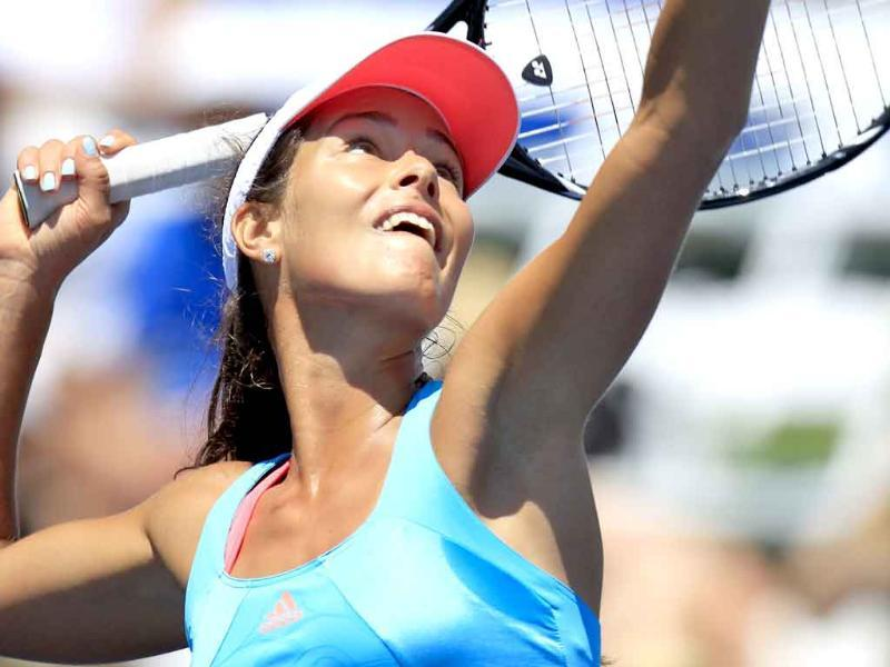 Ana Ivanovic of Serbia lines up an overhead return to Ayumi Morita of Japan during second round play at the WTA tennis tournament in Carlsbad, California.
