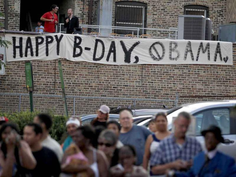 A banner wishes US President Barack Obama a happy birthday outside of the Aragon Entertainment Center in Chicago.