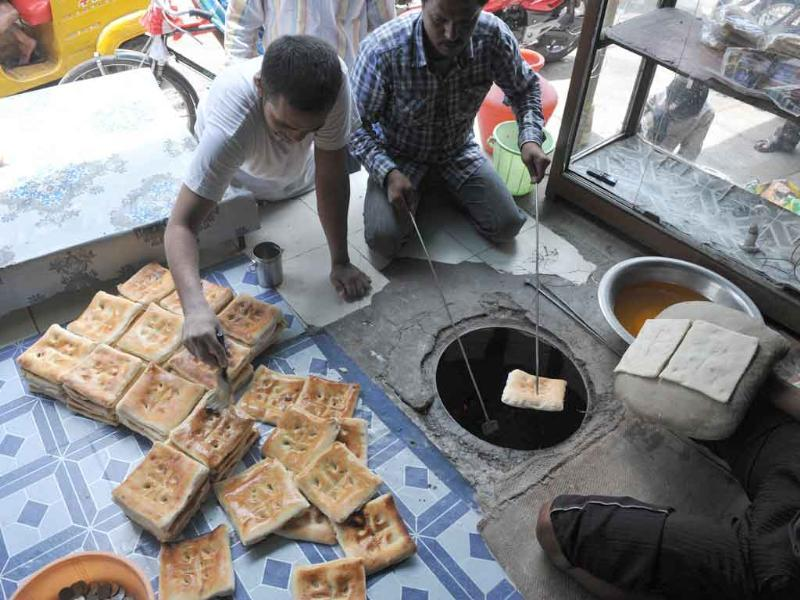 A young Muslim prepares nan bread during the holy month of Ramadan in Hyderabad