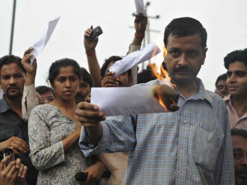Civil society member Arvind Kejriwal burns a copy of the Lokpal Bill during a protest on the outskirts of New Delhi