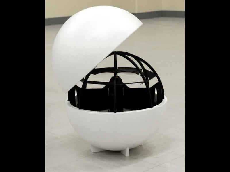 A spherical observation drone designed by Advanced Defense Technology Centre Engineer Fumiyuki Sato is displayed in Tokyo. The Japanese defence researcher has invented a spherical observation drone that can fly down narrow alleys, hover on the spot, take off vertically and bounce along the ground.