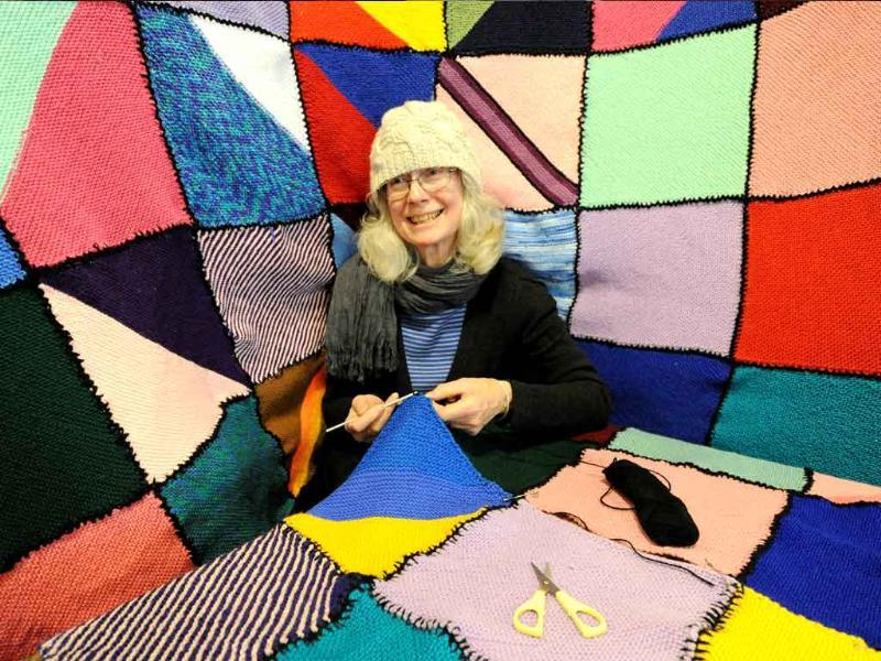 Mimi Daw knits a blanket during the annual 'Knit In' for the 'Wrap With Love' charity in Sydney. Since its inception in 1992, Wrap With Love has knitted and distributed over 250,000 handmade blankets (or wraps) to needy people in Somalia and 70 other countries.