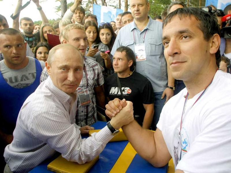 Russian Prime Minister Vladimir Putin prepares to arm wrestle during his visit to the Seliger youth educational forum in the Tver region, Russia.