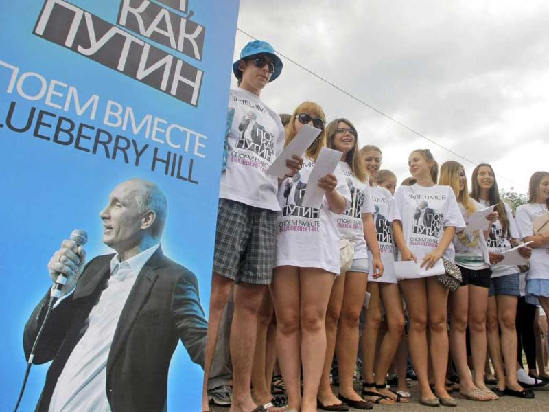 Activists supporting Russian Prime Minister Vladimir Putin sing Blueberry Hill in front of the Russian government building in Moscow, Russia.