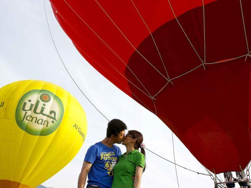 Chang Wei-tzung (L), 31, kisses Minnie Wu, 28, after she accepted his wedding proposal during the Taiwan International Hot Air Balloon Festival in Luye Town, Taitung County.